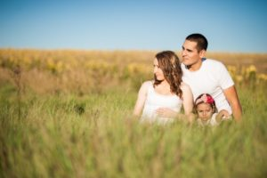happy-family-with-daughter-in-meadow